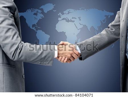 handshake over world map - stock photo