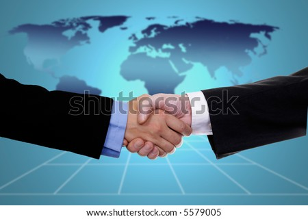 handshake over world map, business or politic concept indicating globalization - stock photo