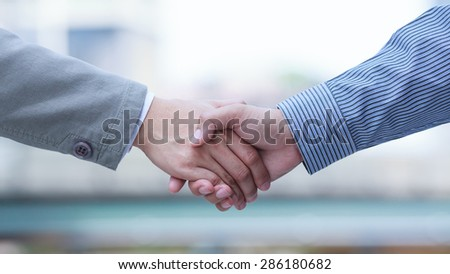 Handshake standing for a trusted partnership - stock photo