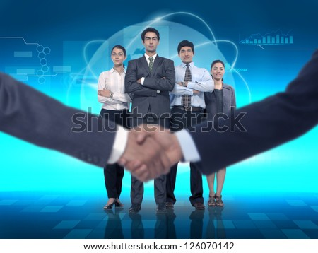 handshake with business team at backdrop showing business partnership - stock photo