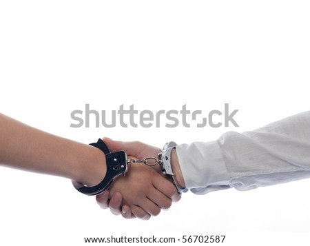 handshake with handcuffs concept agreement isolated studio on white background - stock photo