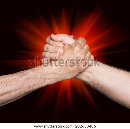 Handshaking. Man's handshake isolated on an abstract background of a red star - stock photo
