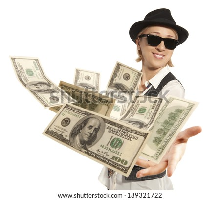 Handsome adult business woman in cap throwing dollar isolated on background - stock photo