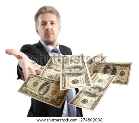 Handsome adult businessman throwing dollar - stock photo