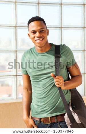 handsome african american boy with a bag - stock photo