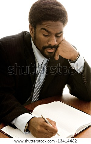 Handsome African-American business working at desk