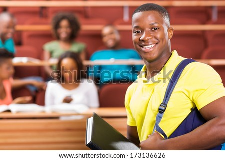 handsome african american college student in lecture hall - stock photo