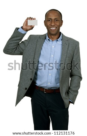 Handsome African American man holding up a business card - stock photo