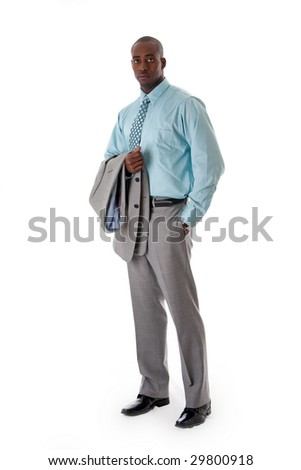 Handsome African American man in gray suit standing with hand in pocket and blazer over arm, isolated - stock photo