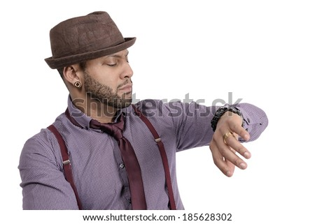Handsome African American young man in hat looking at watch. Copy space - stock photo
