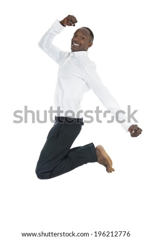 Handsome African Man Jumping High, Studio Shot - stock photo