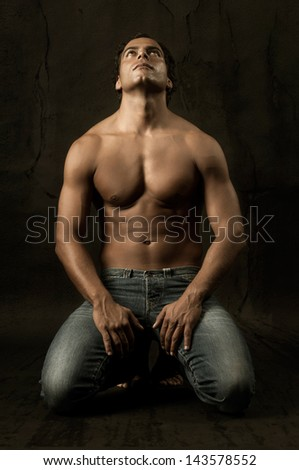 Handsome and muscular man in dark background