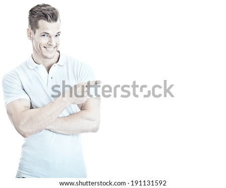 Handsome and sportive young man pointing at empty copyspace, isolated on white - Much room for your own text - stock photo