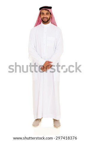 handsome arabic man in thobe standing on white background - stock photo