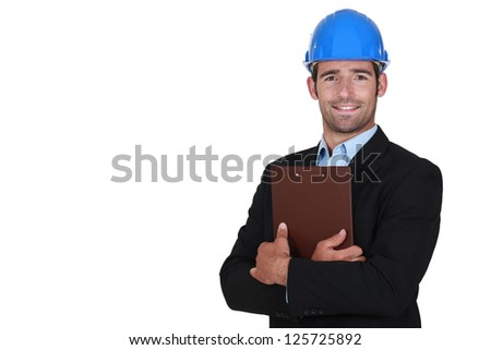 Handsome architect with a clipboard - stock photo
