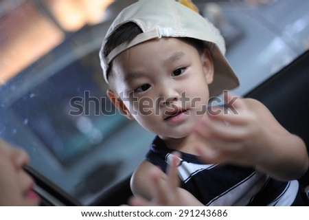 Handsome asian boy play with his mother - stock photo