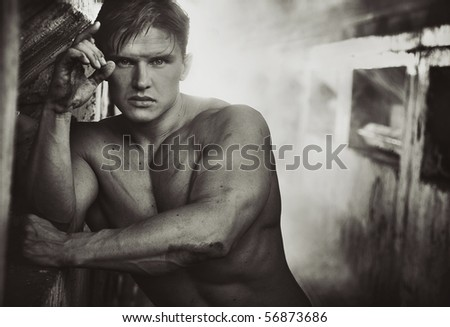 Handsome athlete man in black and white - stock photo