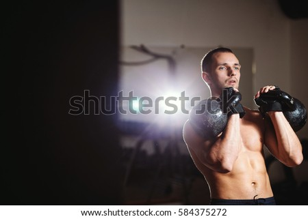 handsome athlete with Kettlebell workout in gym. Caucasian male athlete.