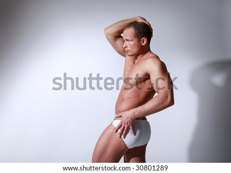 Handsome athletic man with white pants - stock photo