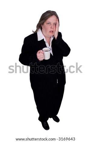 Handsome attractive businesswoman in suit with a cup of coffee in hand with a tired expression on white background with clipping path. - stock photo