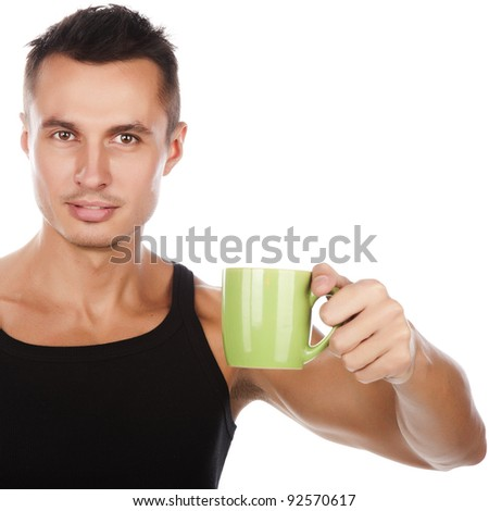handsome attractive man with cup of coffee, man with cup of tea, positive optimistic man with green cup of beverage, isolated on white - stock photo