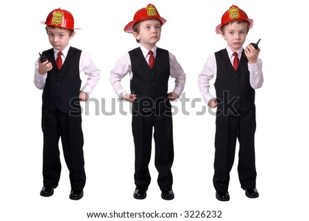 handsome attractive young boy dressed as a fire chief- in suit with helmet and walkie-talkie and hand on hip on white background. - stock photo