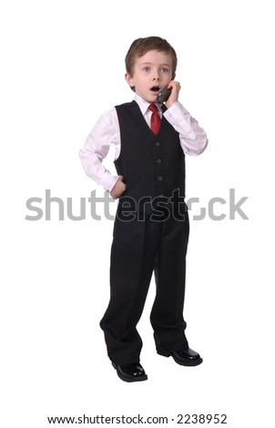handsome attractive young boy dressed in suit with cell phone in hand on white background. - stock photo