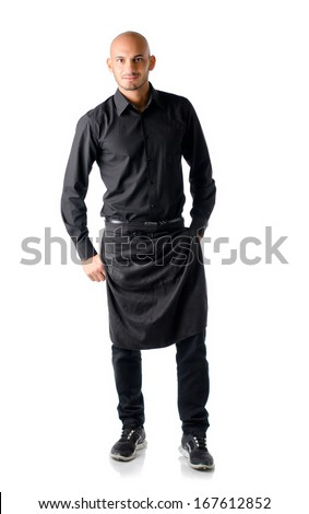 Handsome bald young restaurant or bar waiter, standing isolated on white background, smiling - stock photo