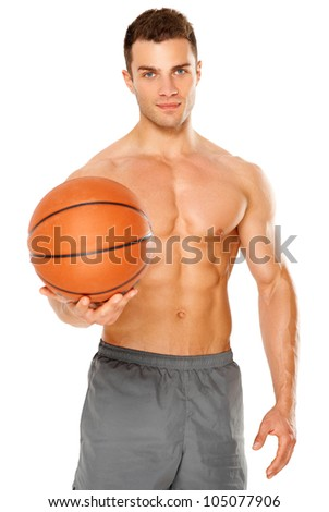 Handsome basketball player holding ball on white background - stock photo