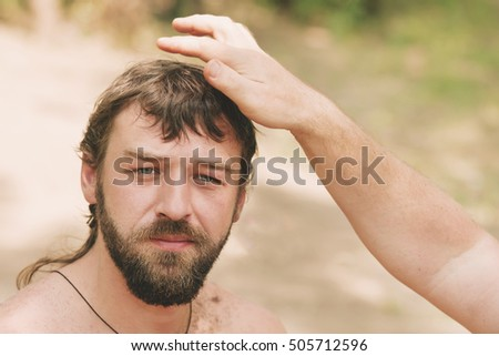 Handsome bearded man during creation hairstyles