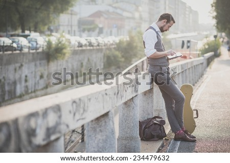 handsome big moustache hipster man in the city - stock photo