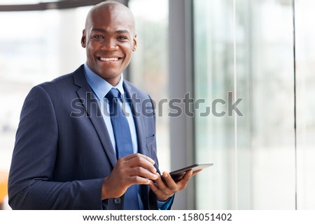 handsome black businessman using tablet pc - stock photo
