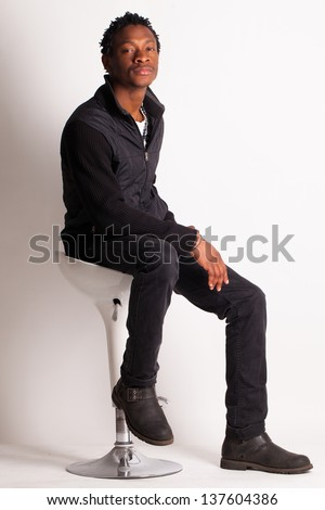 African American Man Sitting In Chair Stock Images
