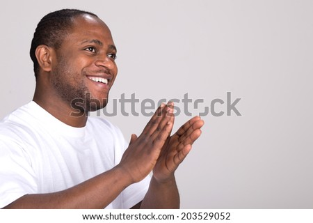 handsome black man clapping hands. attractive male with emotions and smiling - stock photo