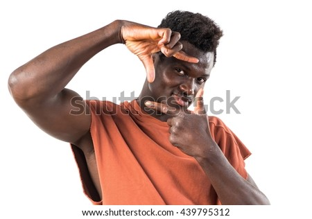 Handsome black man focusing with his fingers