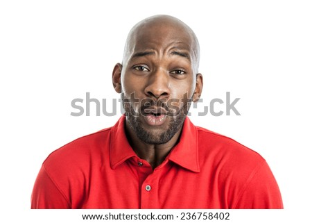 Handsome black man in his 20s making a surprised facial expression isolated on a white background