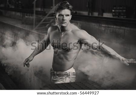 Handsome bodybuilder in black and white - stock photo