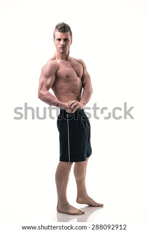 Handsome bodybuilder in classic pecs pose, looking at camera isolated on white - stock photo