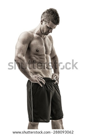 Handsome bodybuilder in relaxed pose, looking down, isolated on white - stock photo