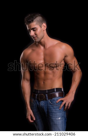 Handsome bodybuilder with a great body posing over a copy space background