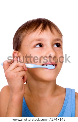handsome boy brushing his teeth on a white background