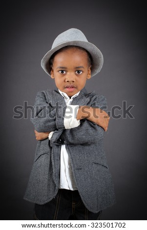Handsome boy doing different expressions in different sets of clothes: arms crossed - stock photo