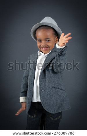 Handsome boy doing different expressions in different sets of clothes: be careful - stock photo