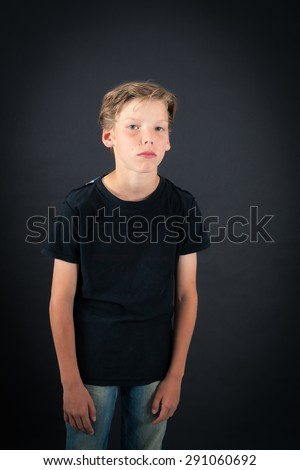 Handsome boy doing different expressions in different sets of clothes: bored - stock photo