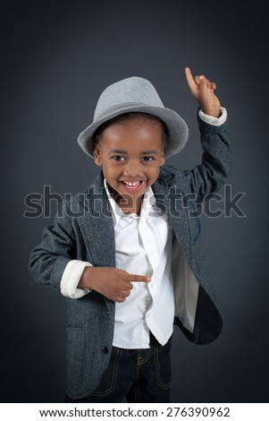Handsome boy doing different expressions in different sets of clothes: idea - stock photo
