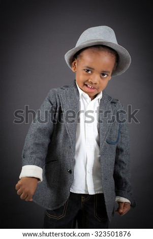 Handsome boy doing different expressions in different sets of clothes: thumbs down - stock photo