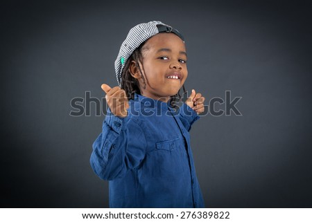 Handsome boy doing different expressions in different sets of clothes: thumbs up - stock photo