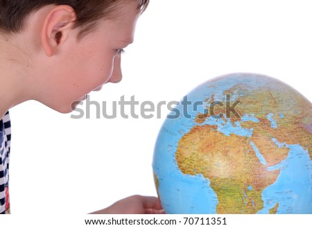 handsome boy looking at globe isolated on white