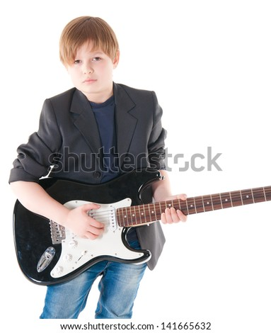 Handsome boy with electric guitar posing.