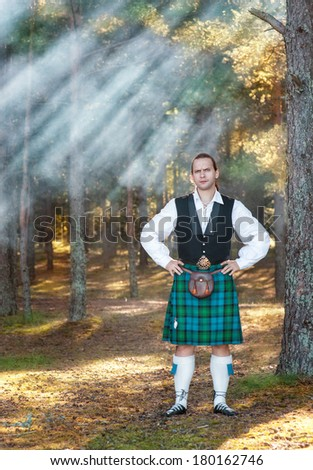 Handsome brave scottish man in the forest  - stock photo
